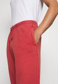 Levi's® - TAB PANT - Tracksuit bottoms - marsala - 3