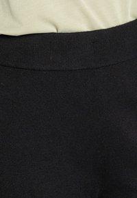 Moss Copenhagen - GALINE RACHELLE PANTS - Verryttelyhousut - black - 4