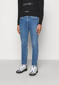 MOSCHINO - TROUSERS - Slim fit jeans - blue - 0