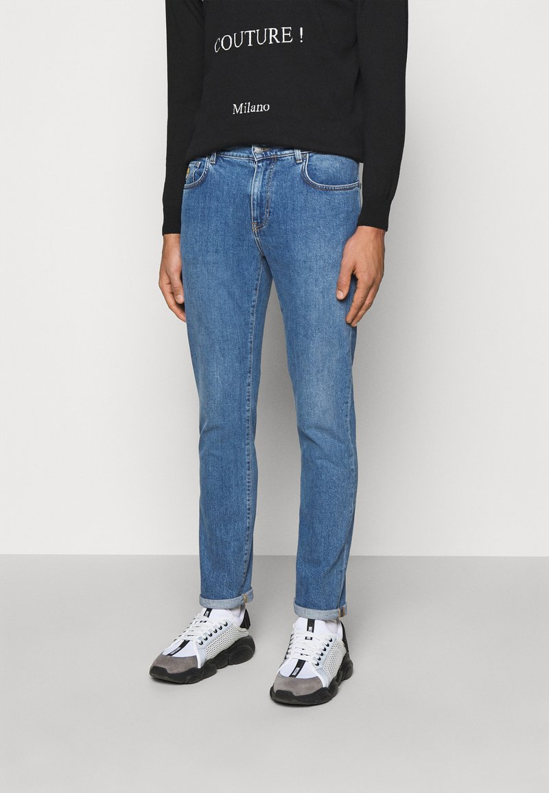 MOSCHINO - TROUSERS - Slim fit jeans - blue