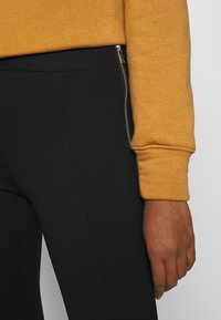 Vero Moda - VMTAVA - Leggings - Trousers - black - 4