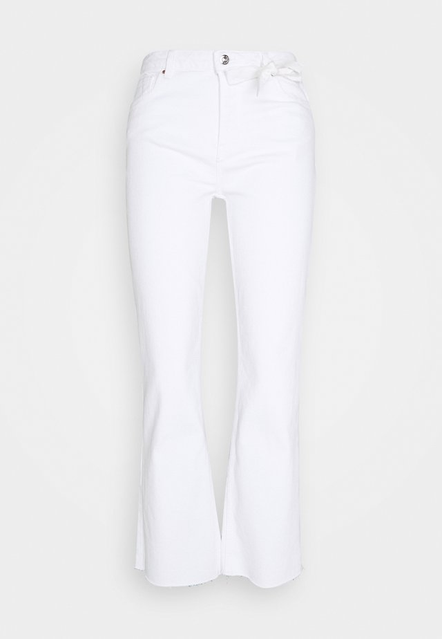 KICK - Flared jeans - white