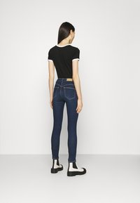 PULL&BEAR - PUSH UP - Skinny džíny - mottled dark blue - 2