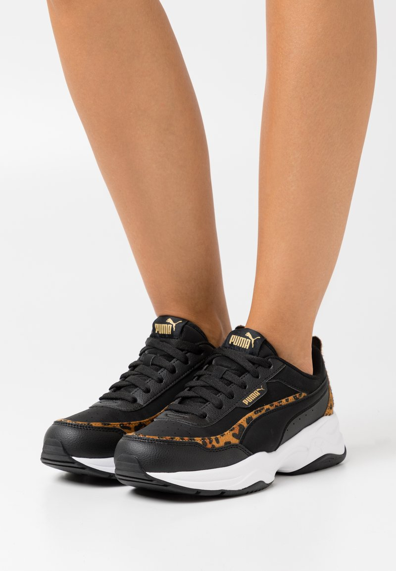 Puma - CILIA MODE LEO - Sneakers basse - black/team gold/white