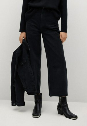 CAROLINE - Flared Jeans - black denim