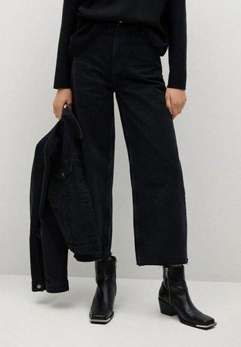 CAROLINE - Flared Jeans - black denim