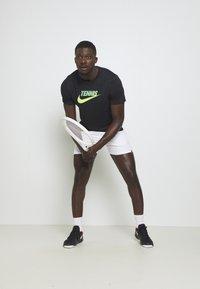 Nike Performance - GRAPHIC - Print T-shirt - black/volt/neo turq - 1