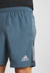 adidas Performance - OWN THE RUN - Pantalón corto de deporte - blue - 4