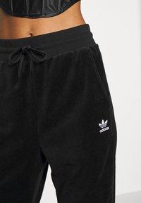 adidas Originals - JOGGER - Tracksuit bottoms - black - 5