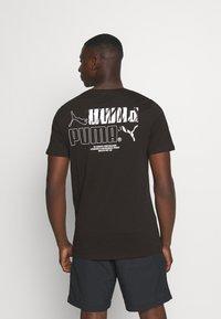 Puma - CLASSICS GRAPHICS LOGO TEE - Print T-shirt - black - 0