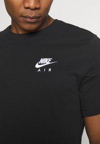 Nike Sportswear - Triko spotiskem - black - 6