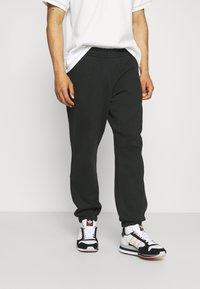 adidas Originals - BASICS UNISEX - Tracksuit bottoms - black - 0