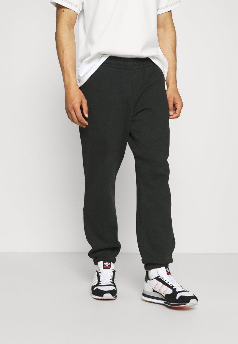adidas Originals - BASICS UNISEX - Tracksuit bottoms - black