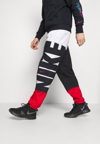 Nike Performance - STARTING PANT - Tracksuit bottoms - white/black/university red - 4