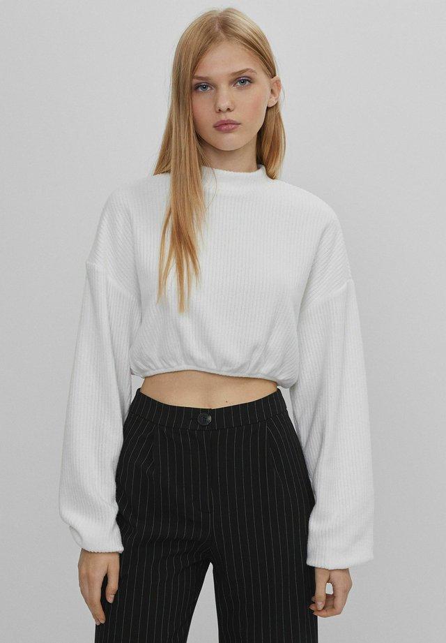 MIT PATENTMUSTER UND GUMMIZUG  - T-shirt à manches longues - stone