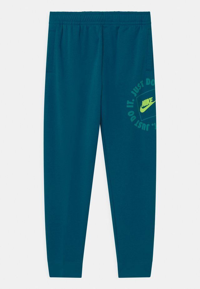 UNISEX - Tracksuit bottoms - green abyss