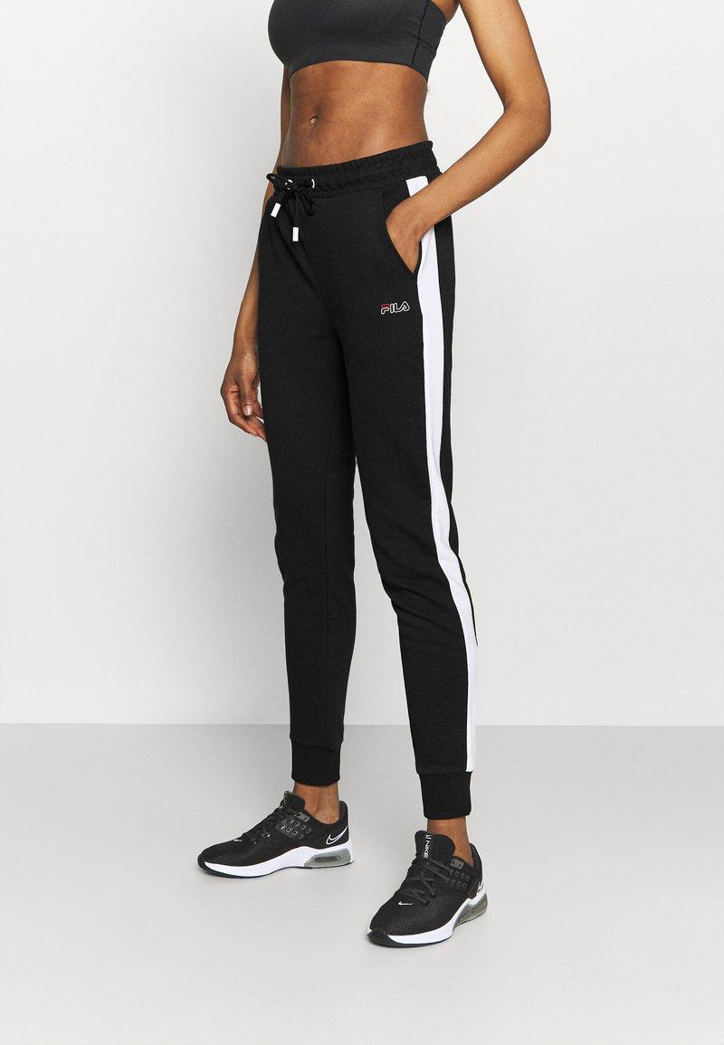 Fila - LAKI PANTS - Spodnie treningowe - black/bright white