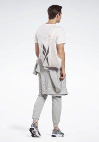 Reebok - TECH STYLE IMAGIRO BAG - Sac à dos - pink - 0