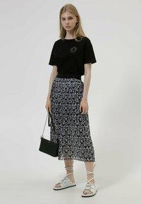 HUGO - HUGO x Smiley® DACHELLE  - Print T-shirt - black - 1
