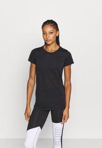 Puma - STUDIO KEYHOLE TEE - Basic T-shirt - black - 0