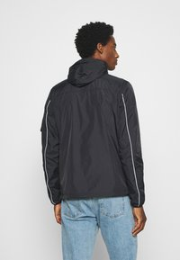 Schott - Windbreaker - black