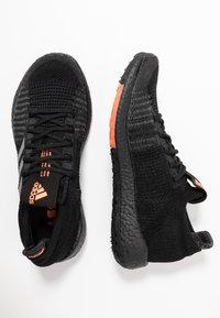 adidas Performance - PULSEBOOST HD - Zapatillas de running neutras - core black/grey three/signal coral - 1