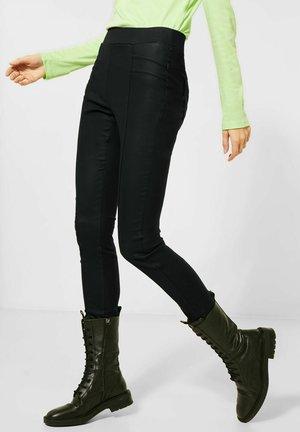 MIT COATING - Trousers - schwarz