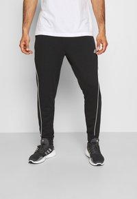 adidas Performance - FAVS  - Tracksuit bottoms - black/white - 0