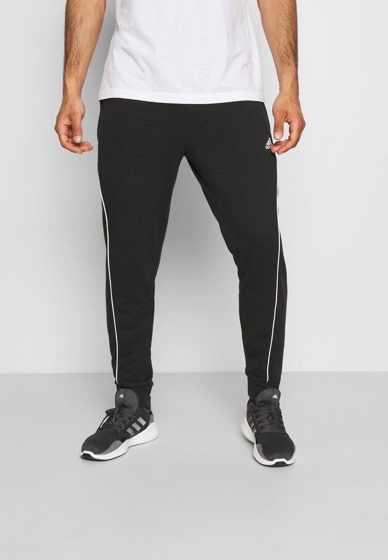 adidas Performance - FAVS  - Tracksuit bottoms - black/white