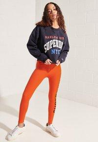 Superdry - Leggings - Trousers - bold orange - 0