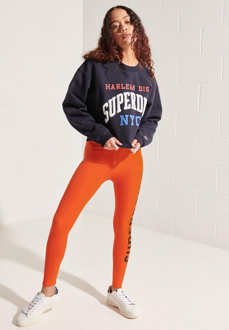 Superdry - Leggings - Trousers - bold orange