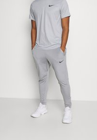 Nike Performance - PANT CAPRA - Pantaloni sportivi - particle grey/black - 0