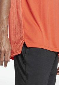 Reebok - WORKOUT READY TECH - Sports shirt - red - 4