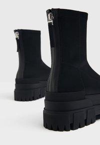 Bershka - Platform ankle boots - black - 6