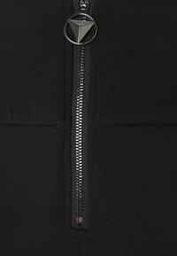 Guess - HUDA PANTS - Trousers - jet black - 5
