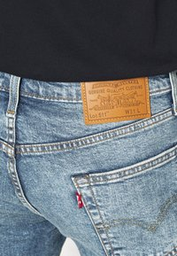 Levi's® - 511™ SLIM HEMMED SHORT - Denim shorts - med indigo - worn in - 4