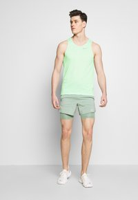 Nike Performance - RISE TANK - Sports shirt - pistachio frost - 1