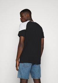 Puma - ICONIC TEE - T-shirt med print - black - 2
