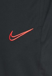 Nike Performance - ACADEMY 21 PANT - Tracksuit bottoms - black/siren red - 6