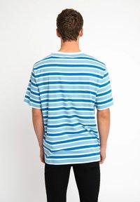 Urban Threads - T-shirts print - blue - 1