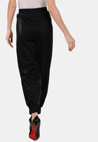 faina - Tracksuit bottoms - black - 2