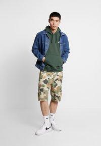 Nike Sportswear - CLUB HOODIE - Felpa con cappuccio - galactic jade/white - 1