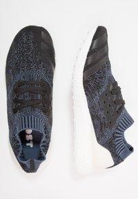 adidas Performance - ULTRABOOST UNCAGED PARLEY - Obuwie do biegania treningowe - tech ink/core black - 1