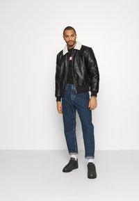 Karl Kani - RETRO JACKET - Faux leather jacket - black - 1