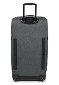Eastpak - TRANVERZ L CORE COLORS - Wheeled suitcase - black denim - 4