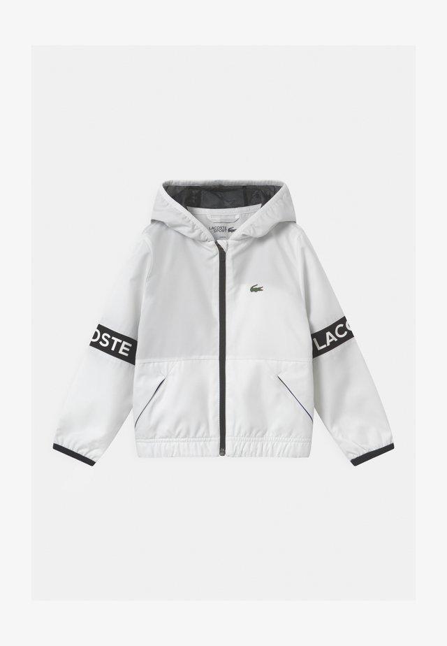 UNISEX - Training jacket - blanc/noir cosmique
