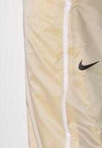 Nike Sportswear - PANT - Tracksuit bottoms - dark citron/white/black - 3