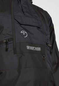 The North Face - STEEP TECH LIGHT RAIN JACKET - Waterproof jacket - black - 4
