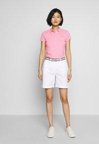 Tommy Hilfiger - NEW SHORT SLEEVE SLIM - Poloskjorter - matte pink - 1
