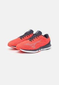 Mizuno - WAVE SHADOW 4 - Competition running shoes - ignition red/wan blue/india ink - 1